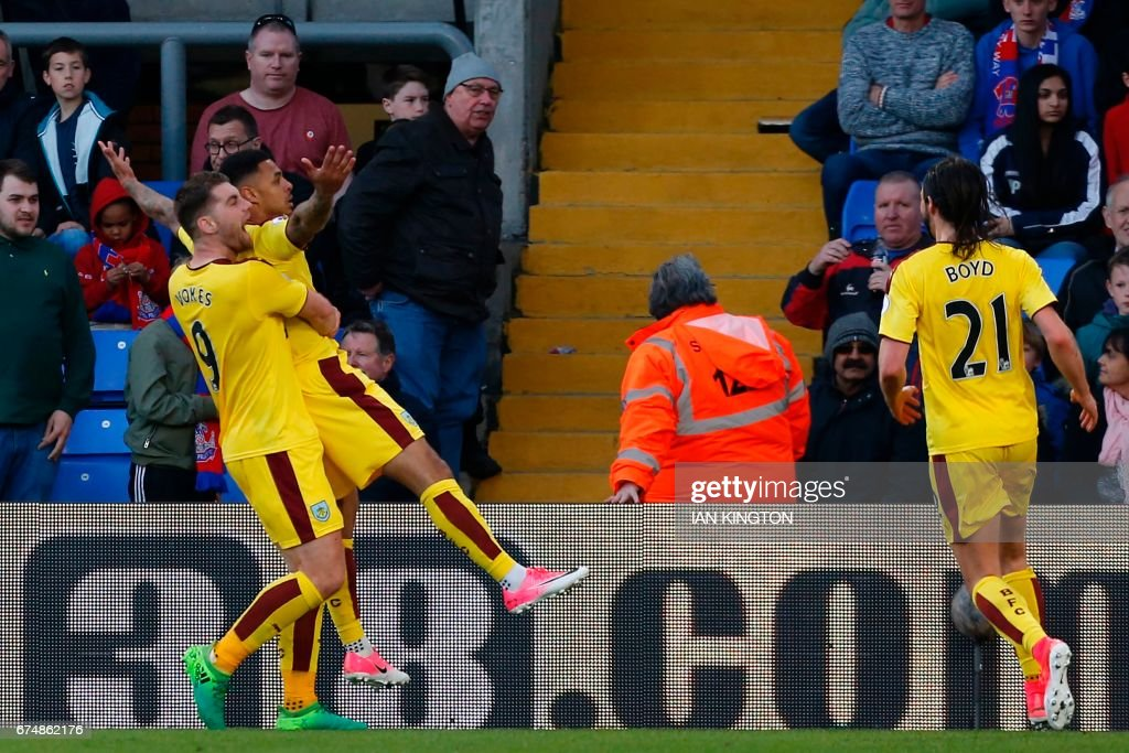 Burnley's English striker Andre Gray (2nd L) celebrates with Burnley's Welsh striker Sam Vokes after scoring their second goal during the English Premier League football match between Crystal Palace and Burnley at Selhurst Park in south London on April 29, 2017. Burnley won the game 2-0. / AFP PHOTO / Ian KINGTON / RESTRICTED TO EDITORIAL USE. No use with unauthorized audio, video, data, fixture lists, club/league logos or 'live' services. Online in-match use limited to 75 images, no video emulation. No use in betting, games or single club/league/player publications. /
