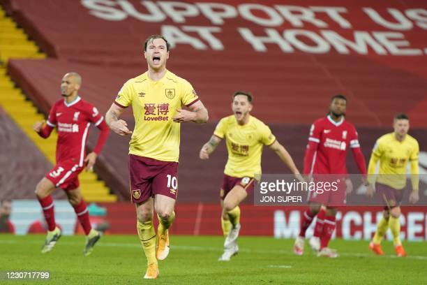 Burnley's English striker Ashley Barnes celebrates scoring the opening goal from the penalty spot during the English Premier League football match...