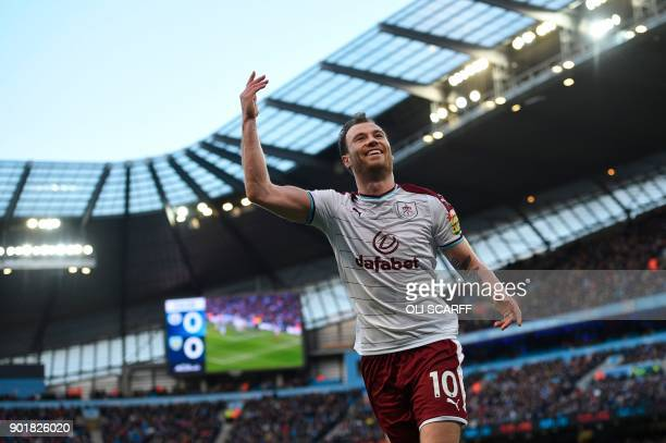 Burnley's English striker Ashley Barnes celebrates scoring the opening goal during the English FA Cup third round football match between Manchester...