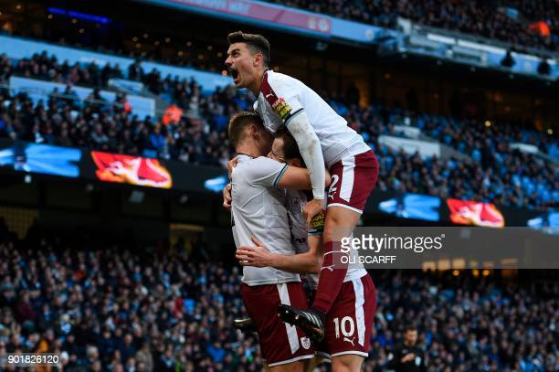 Burnley's English striker Ashley Barnes celebrates scoring the opening goal with Burnley's English defender Matthew Lowton during the English FA Cup...