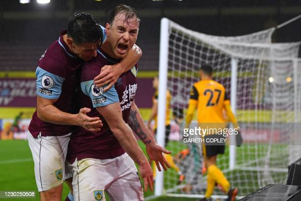 Burnley's English striker Ashley Barnes celebrates with Burnley's English midfielder Ashley Westwood after scoring their first goal during the...
