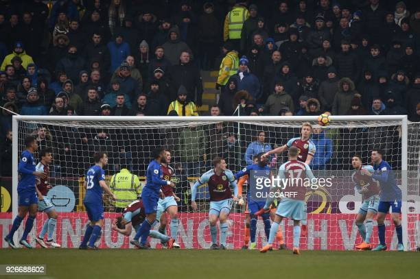 Burnley's English striker Ashley Barnes falls to the ground after a clash with Everton's Englishborn Welsh defender Ashley Williams who is...