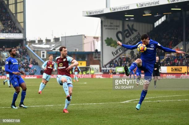 Burnley's English striker Ashley Barnes has his shot blocked by Everton's English defender Michael Keane during the English Premier League football...