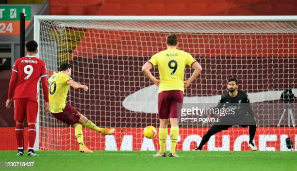 Burnley's English striker Ashley Barnes scores the opening goal from the penalty spot during the English Premier League football match between...