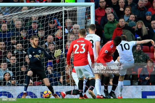 Burnley's English striker Ashley Barnes scores the opening goal of the English Premier League football match between Manchester United and Burnley at...