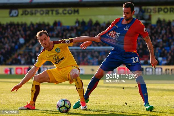 Burnley's English striker Ashley Barnes vies with Crystal Palace's Irish defender Damien Delaney during the English Premier League football match...