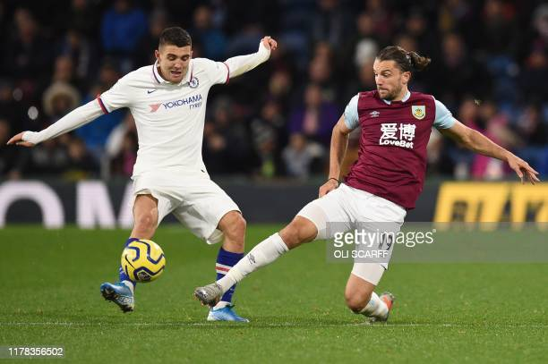 Burnley's English striker Jay Rodriguez attempts to block Chelsea's US midfielder Christian Pulisic during the English Premier League football match...