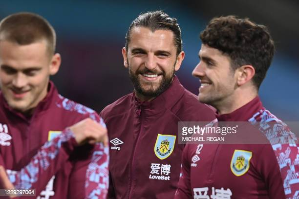 Burnley's English striker Jay Rodriguez smiles as he warms up ahead of the English Premier League football match between Burnley and Tottenham...