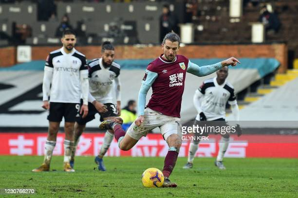 Burnley's English striker Jay Rodriguez takes a penalty kick to score their second goal during the English FA Cup fourth round football match between...