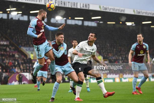 Burnley's Englishborn Scottish defender Phil Bardsley heads clear during the English Premier League football match between Burnley and Liverpool at...