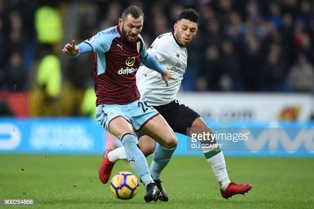 Burnley's Englishborn Scottish defender Phil Bardsley vies with Liverpool's English midfielder Alex OxladeChamberlain during the English Premier...