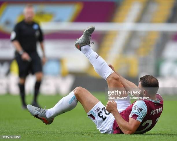 Burnley's Erik Pieters is injured during the Premier League match between Burnley FC and Brighton Hove Albion at Turf Moor on July 26 2020 in Burnley...
