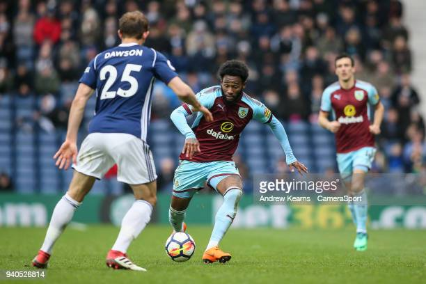 Burnley's GeorgesKevin Nkoudou challenging West Bromwich Albion's Craig Dawson during the Premier League match between West Bromwich Albion and...