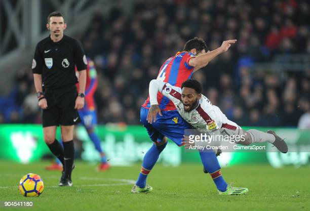 Burnley's GeorgesKevin Nkoudou is fouled by Crystal Palace's Luka Milivojevic during the Premier League match between Crystal Palace and Burnley at...