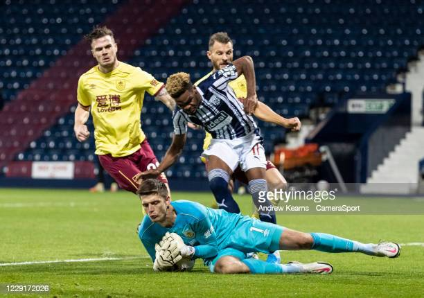 Burnley's goalkeeper Nick Pope saves under pressure from West Bromwich Albion's Grady Diangana during the Premier League match between West Bromwich...