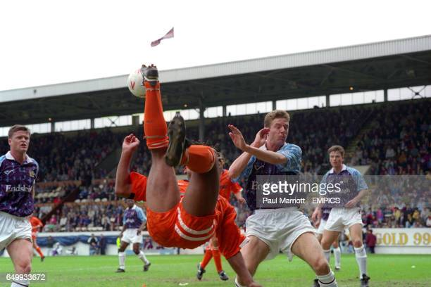 Burnley's Ian Measham is unable to stop an overhead kick by Blackpool's Trevor Sinclair