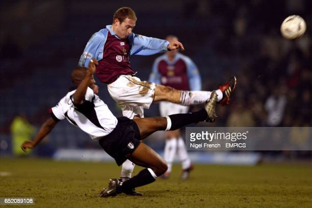 Burnley's Ian Moore shoots goalwards under pressure from Fulham's Luis Boa Morte