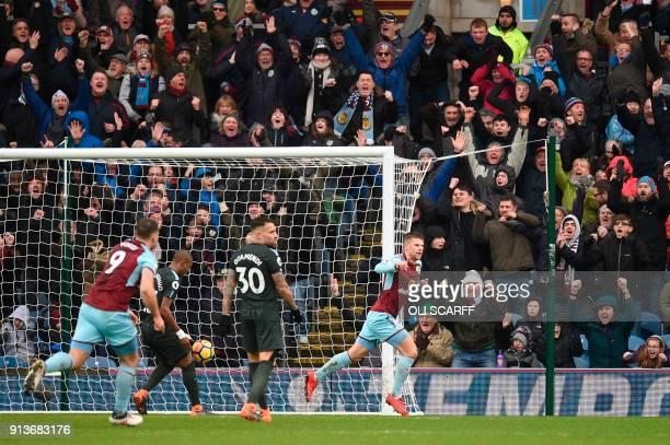 Burnley's Icelandic midfielder Johann Berg Gudmundsson celebrates scoring their first goal to equalise 11 during the English Premier League football...