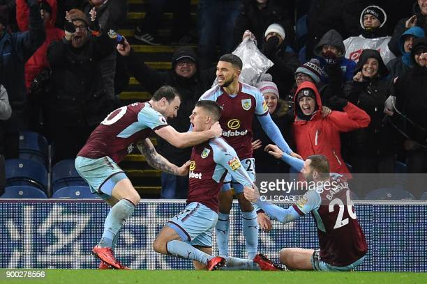 Burnley's Icelandic midfielder Johann Berg Gudmundsson celebrates with teammates after scoring their first goal during the English Premier League...
