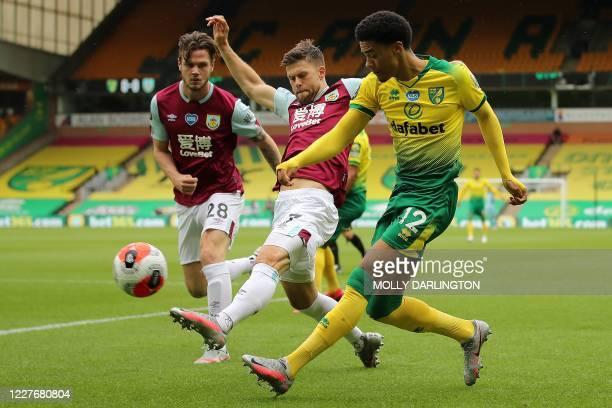 Burnley's Irish defender Kevin Long and Burnley's Icelandic midfielder Johann Berg Gudmundsson and Norwich City's English-born Northern Irish...