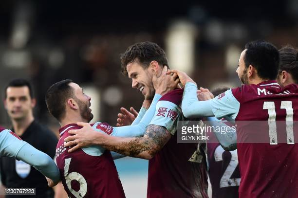 Burnley's Irish defender Kevin Long celebrates scoring his team's third goal with Burnley's Scottish defender Phil Bardsley during the English FA Cup...
