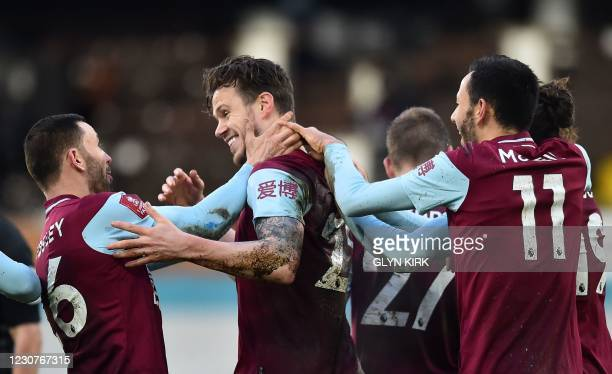Burnley's Irish defender Kevin Long celebrates scoring his team's third goal with his teammates during the English FA Cup fourth round football match...