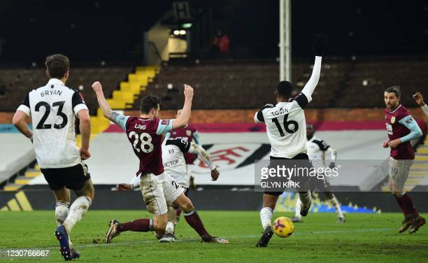 Burnley's Irish defender Kevin Long scores his team's third goal during the English FA Cup fourth round football match between Fulham and Burnley at...