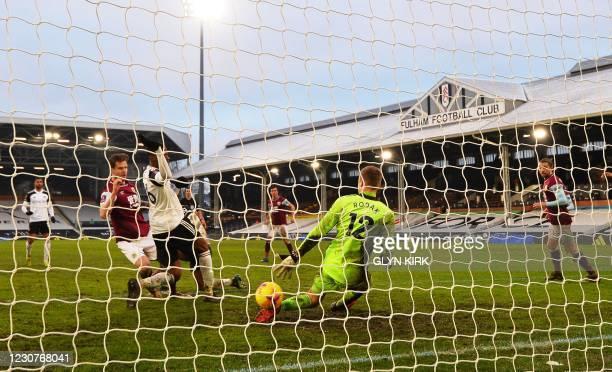 Burnley's Irish defender Kevin Long scores his team's third goal past Fulham's Slovakian goalkeeper Marek Rodak during the English FA Cup fourth...