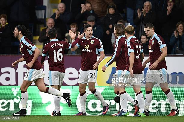 Burnley's Irish defender Stephen Ward celebrates with teammates after scoring their second goal during the English Premier League football match...