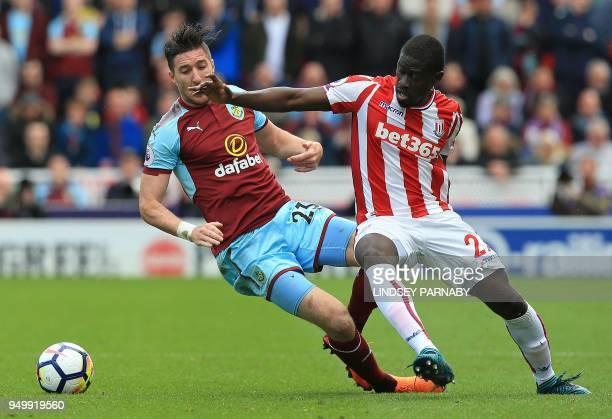 Burnley's Irish defender Stephen Ward vies with Stoke City's Senegalese defender Badou Ndiaye during the English Premier League football match...