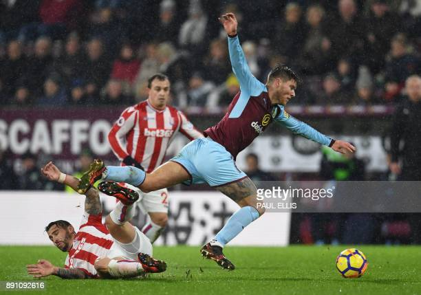 Burnley's Irish midfielder Jeff Hendrick is tackled by Stoke City's US defender Geoff Cameron during the English Premier League football match...