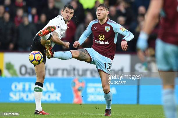 Burnley's Irish midfielder Jeff Hendrick vies with Liverpool's Croatian defender Dejan Lovren during the English Premier League football match...