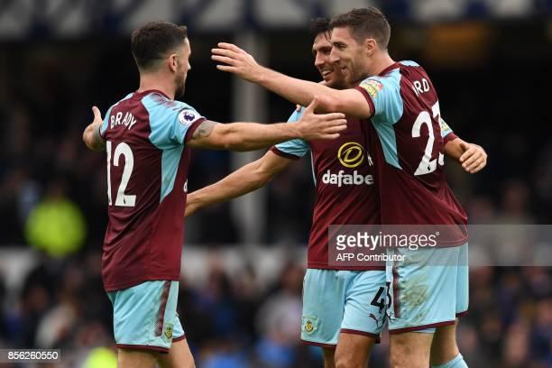 Burnley's Irish midfielder Robbie Brady celebrates on the pitch with Burnley's English midfielder Jack Cork and Burnley's Irish defender Stephen Ward...