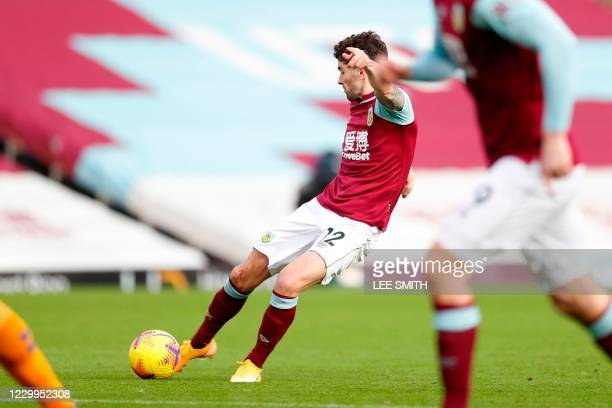 Burnley's Irish midfielder Robbie Brady scores the opening goal during the English Premier League football match between Burnley and Everton at Turf...