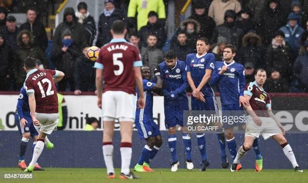 Burnley's Irish midfielder Robbie Brady scores their first goal from this freekick during the English Premier League football match between Burnley...