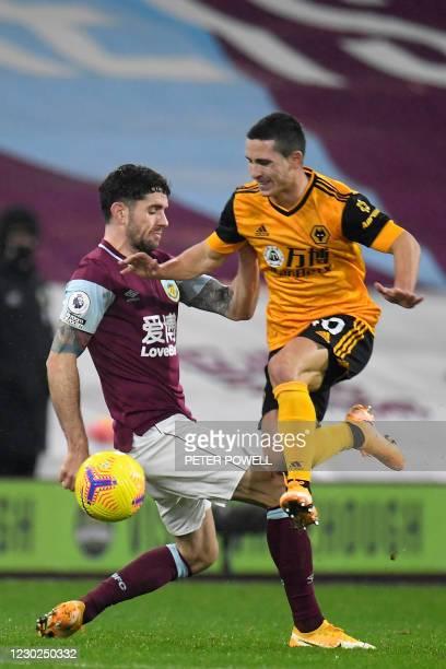 Burnley's Irish midfielder Robbie Brady vies with Wolverhampton Wanderers' Portuguese midfielder Daniel Podence during the English Premier League...