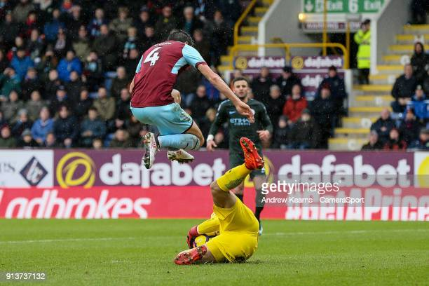Burnley's Jack Cork avoids a collision with Manchester City's goalkeeper Ederson during the Premier League match between Burnley and Manchester City...