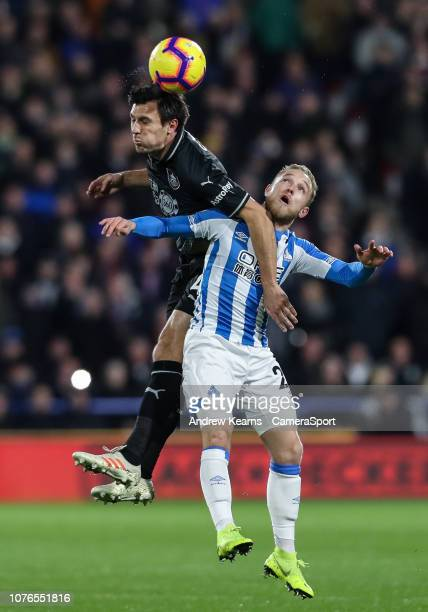Burnley's Jack Cork competing with Huddersfield Town's Alex Pritchard during the Premier League match between Huddersfield Town and Burnley FC at...
