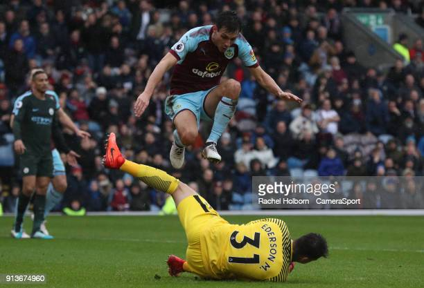 Burnley's Jack Cork forces a save from Manchester City's Ederson during the Premier League match between Burnley and Manchester City at Turf Moor on...