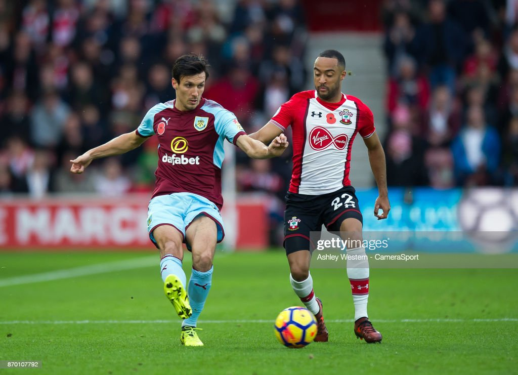 Burnley's Jack Cork holds off the challenge from Southampton's Nathan Redmond during the Premier League match between Southampton and Burnley at St Mary's Stadium on November 4, 2017 in Southampton, England.