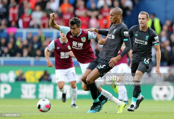 Burnley's Jack Cork is fouled by Liverpool's Fabinho during the Premier League match between Burnley FC and Liverpool FC at Turf Moor on August 31...
