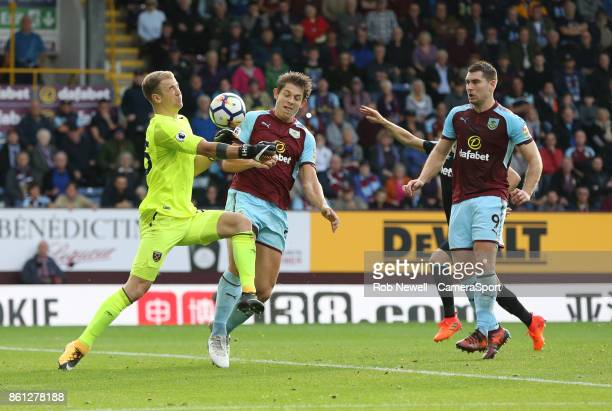 Burnley's James Tarkowski and West Ham United's Joe Hart during the Premier League match between Burnley and West Ham United at Turf Moor on October...