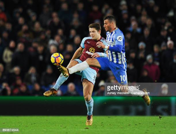 Burnley's James Tarkowski battles for possession with Brighton Hove Albion's Tomer Hemed during the Premier League match between Brighton and Hove...