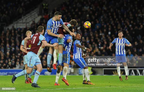 Burnley's James Tarkowski beats Brighton Hove Albion's Shane Duffy to a header during the Premier League match between Brighton and Hove Albion and...