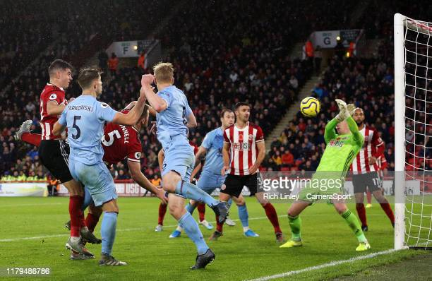 Burnley's James Tarkowski forces the first save of the match from Sheffield United's Dean Henderson during the second half during the Premier League...