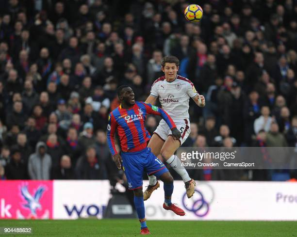 Burnley's James Tarkowski vies for possession with Crystal Palace's Christian Benteke during the Premier League match between Crystal Palace and...