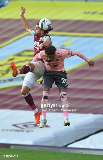 Burnley's Jay Rodriguez battles with Sheffield Uniteds Jayden Bogle during the Carabao Cup Second Round Northern Section match between Burnley and...