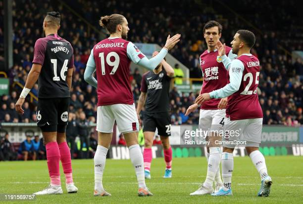 Burnley's Jay Rodriguez celebrates scoring the opening goal with team-mates Jack Cork and Aaron Lennon during the FA Cup Third Round match between...