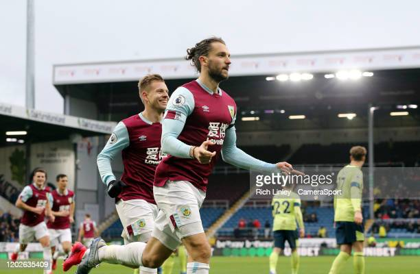 Burnley's Jay Rodriguez celebrates with team-mate Matej Vydra after scoring his side's second goal from the penalty spot after Bournemouth had their...