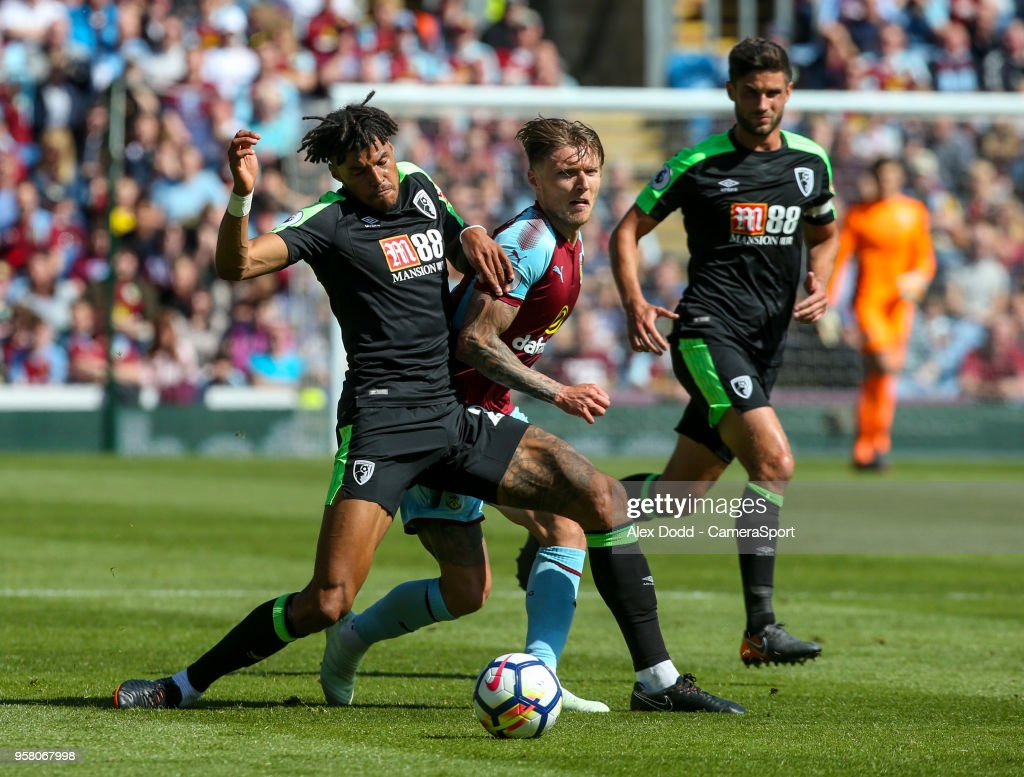 Burnley's Jeff Hendrick battles with Bournemouth's Tyrone Mings during the Premier League match between Burnley and AFC Bournemouth at Turf Moor on May 13, 2018 in Burnley, England.